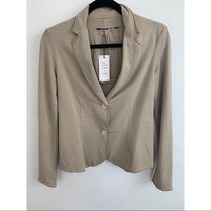 Brand new. Long sleeved jacket in khaki. $55 obo